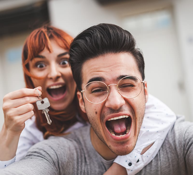 Couple with Keys to their new home